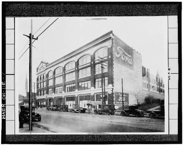 Photocopy of early 20th century photograph, looking east, of east facade of assembly building on Euclid Ave.