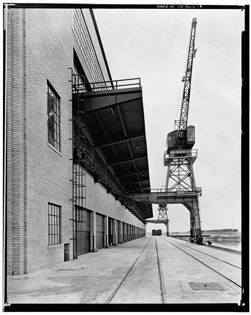 Ford Long Beach Assembly Plant Apr 13, 1930, EAST SIDE OF WAREHOUSE AND LOADING DOCK, SHOWING CRANE, LOOKING NORTH