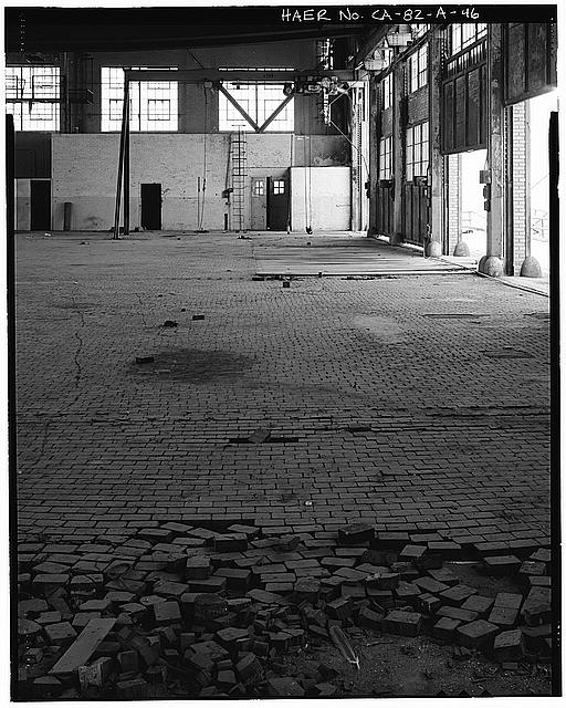Ford Long Beach Assembly Plant NORTHEAST CORNER OF SECOND FLOOR WAREHOUSE, WITH DETAIL OF WOODEN BLOCK FLOORING. VIEW TO NORTH.