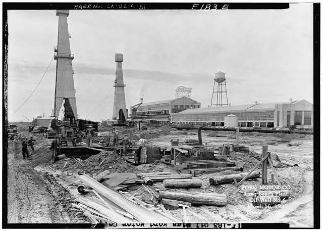 Ford Long Beach Assembly Plant Mar 16, 1937, EXTERIOR-FORD ASSEMBLY PLANT EAST SIDE, SHOWING OIL WELL #6 IN THE FOREGROUND, NORTHEAST OF THE ASSEMBLY PLANT