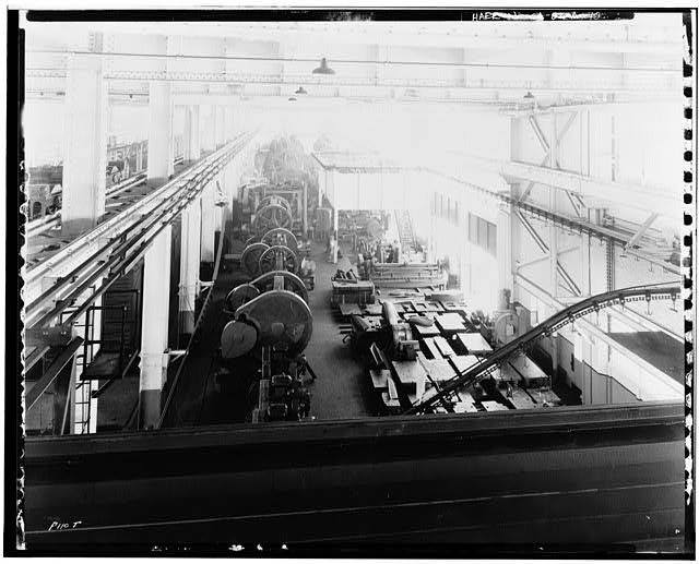 Ford Long Beach Assembly Plant Apr 24, 1931, INTERIOR-PRESSED STEEL BUILDING, EAST SIDE, SHOWING MECHANICAL SYSTEMS, PRESSED STEEL MACHINERY, CONVEYOR LINES
