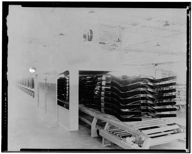 Ford Long Beach Assembly Plant Apr 1, 1932, INTERIOR-ASSEMBLY BUILDING, CONVEYOR LINE WITH CAR CHASSIS