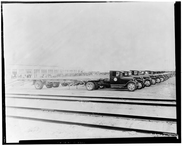 Ford Long Beach Assembly Plant Aug 11, 1930, EXTERIOR-ASSEMBLY BUILDING, NORTH SIDE, WITH TAYLOR-TRUCK-A-WAY TRUCKS AND TRAILORS