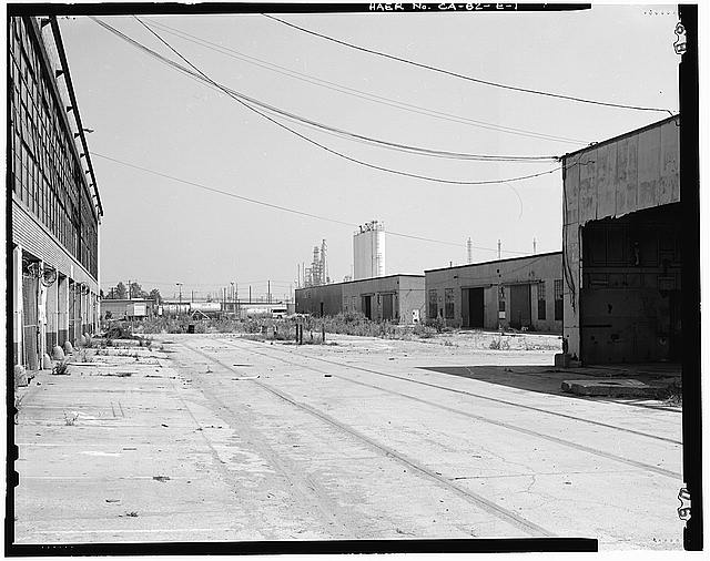 Ford Long Beach Assembly Plant VIEW TO NORTH SHOWING RAIL SPUR, SHEDS, AND NORTHWEST CORNER OF SHED A, AT RIGHT.