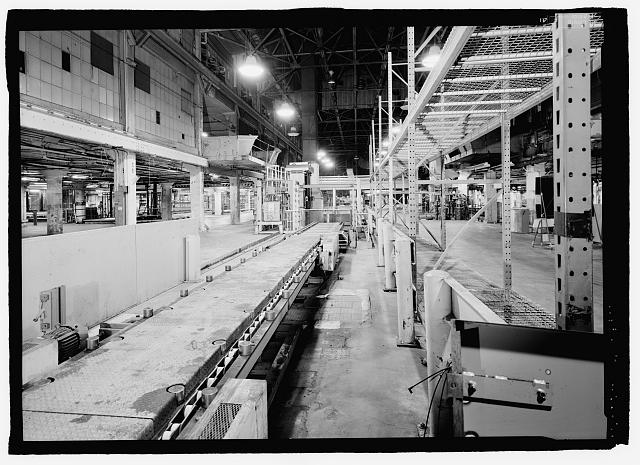 Ford River Rouge Plant B Building SOUTHERN END OF ASSEMBLY PLANT, LOOKING N ON SECOND FLOOR, WHICH DID NOT EXIST ON DURING SHIP BUILDING DAYS. NOTE VEHICLE ELEVATOR. ABOVE AND TO THE LEFT IS SHIP BUILDING BALCONY.