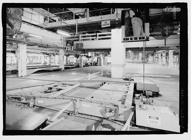 Ford River Rouge Plant B Building LOOKING SOUTH BETWEEN X5 AND X6 AT COLUMN 71, SOUTH END OF ASSEMBLY PLANT ON SECOND FLOOR. CAR CONVEYOR WITH GEAR TO THE REAR SIGN.