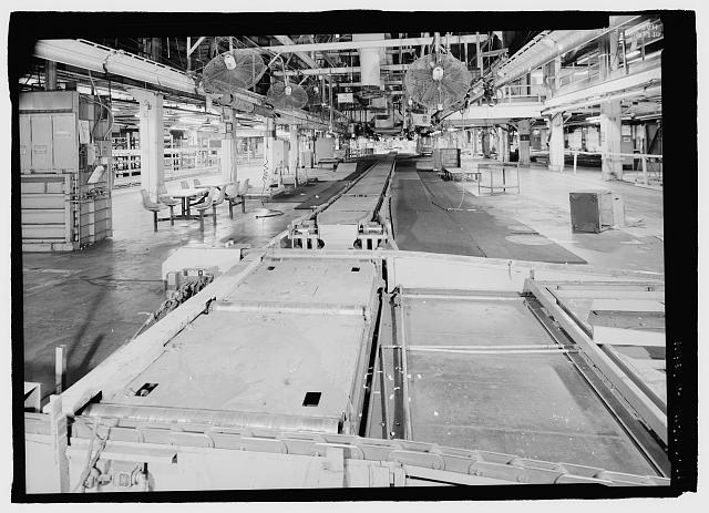 Ford River Rouge Plant B Building SOUTH END, LOOKING NORTH AT CONVEYOR LINE BETWEEN X5 AND X6 AT COLUMN 71, SECOND FLOOR. NOTE WORKERS TABLES.